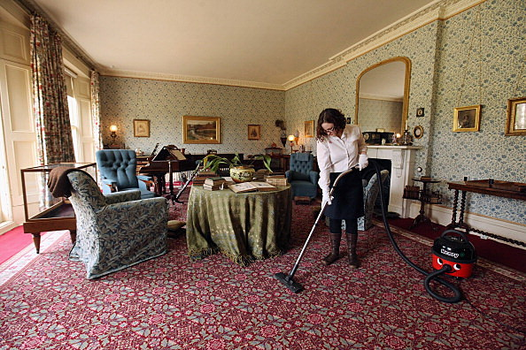 Woman cleaning a room