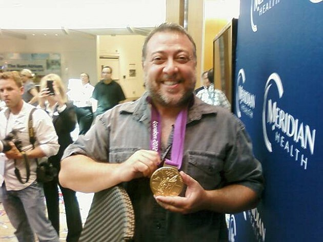 Lou with Christie's gold medal