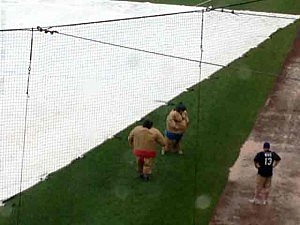 Sumo wrestlers during the BlueClaws rain delay