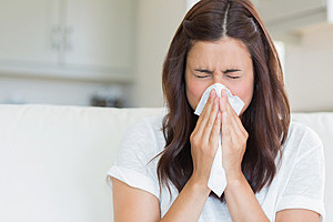 sneezing woman